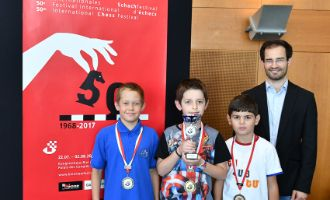 Podium of the U10 Youth Tournament: Sergey Maranin (2nd), Athanasios Zafeiridis (winner), Narek Malkhasyan (3rd) and GM Yannick Pelletier (Director of the Grandmaster Tournament Biel)