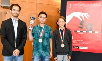 Podium of the U13 Youth Tournament: GM Yannick Pelletier (Director of the Grandmaster Tournament Biel), Hovhannes Mkrtchyan (winner) and Niels Stijve (3rd)