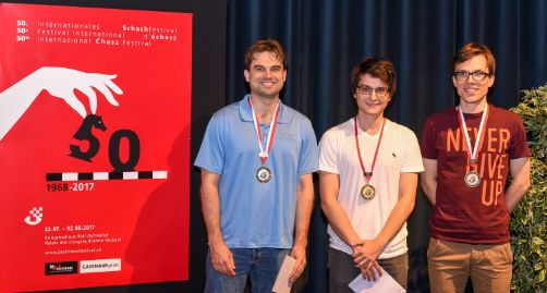 Image Podium of the Rapid Tournament: GM Samuel Shankland (2nd), GM Lagarde Maxime (winner) and GM Bartel Mateusz (3rd)