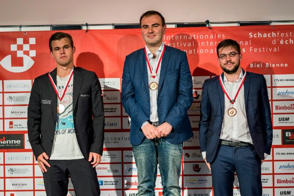 Image Podium of the ACCENTUS Grandmaster Tournament: GM Magnus Carlsen (2nd), Shakhriyar Mamedyarov (winner) and Maxime Vachier-Lagrave (3rd)